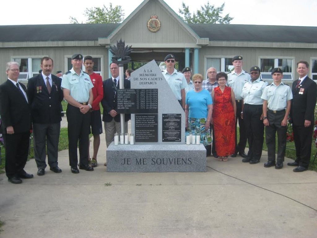 Members of the RMR Family by the Cadet Memorial