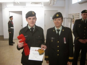 Captain Brooker promoting a Cadet Sergeant