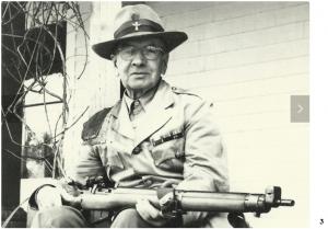 Alexander Parnell poses with his rifle in 1956. He has just earned, at age 75, a place on the  Canadian rifle shooting team, setting a record for oldest team member that has yet to be broken.