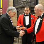Romeo Dallaire receiving plaque from the RSM