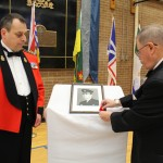 Poppy ceremony for Colonel Lawson's portrait