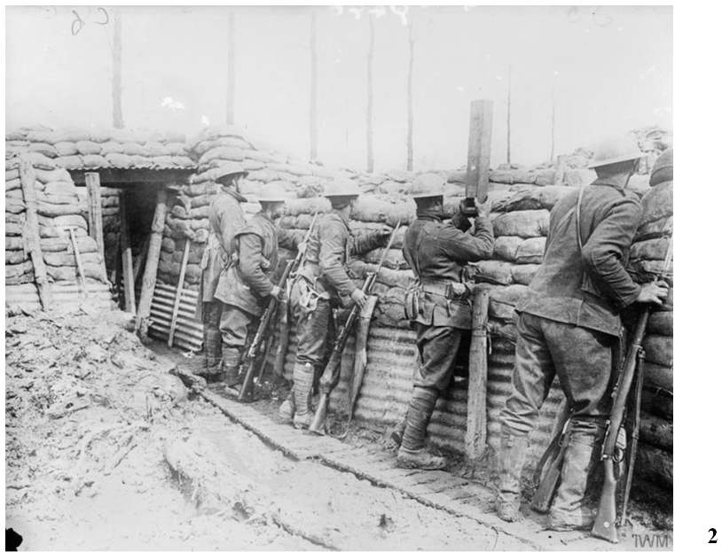 Canadian 1st Division, Ploegsteert, March 20, 1916 after the Canadians had been issued with steel helmets. This photo gives an idea of trench conditions. Note the soldier second from right using a trench periscope.