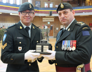"Corporal Inthachit receives the ""Riendeau Reward"" from the CO, LCol Paul Langlais, MSC, CD - 03 May 2015"