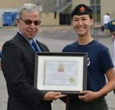 Cadet Corporal Carbert receiving her award