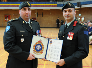 Captain Vincent receiving commendation from Colonel Chafai. Photo: Cplc Julie Turcotte, 34e Groupe-brigade du Canada