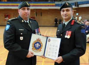 Captain Vincent receiving commendation from Colonel Chafai. Photo: Cplc Julie Turcotte, 34e Groupe-brigade du Canada