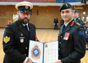 PO2 Chabassol receiving commendation from Colonel Chafai. Photo: Cplc Julie Turcotte, 34e Groupe-brigade du Canada