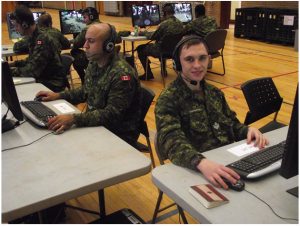 Cpl Cortes and MCpl Tarabanko filling their positions in an offensive operation on the VBS-2 system during The Royal Montreal Regiments exercise in late November 2015. Photo: Capt M.J. Szostak, RMR UPAR.