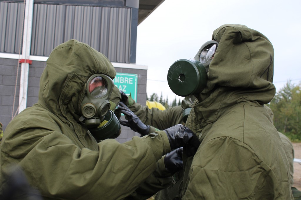 RMR soldiers checking their CBRN equipment outside of the gas hut on Exercise RENEWED VIGOR in 2013