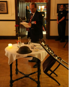 Comrade Bill Thibault explaining the significance of the table set for our fallen & missing comrades. Photo credit: Gary Donovan