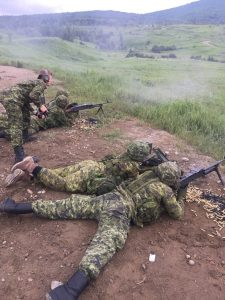 Master Corporal Lees from the Black Watch overseeing course candidates shelling bullets on a C6 General Purpose Machine Gun range at CFB Valcartier. Photo credit : Captain Dexter Ruiz-Laing
