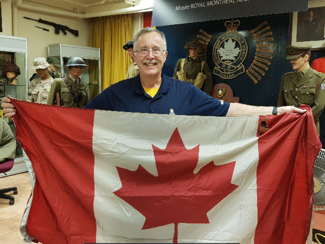 RMR Museum curator Ron Zemancik proudly displaying the Canadian flag recently donated