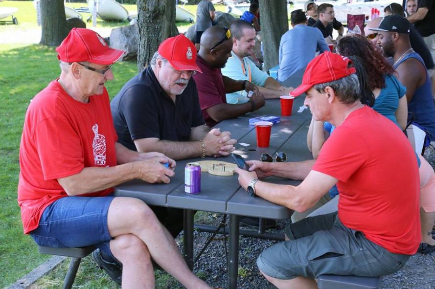 Comrades catching up over a game of cribbage