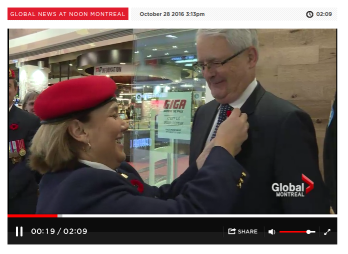 Comrade Sue Guerin pinning a poppy on MP Marc Garneau