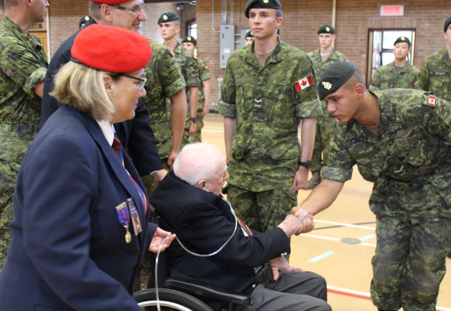 mann-congratulating-soldier